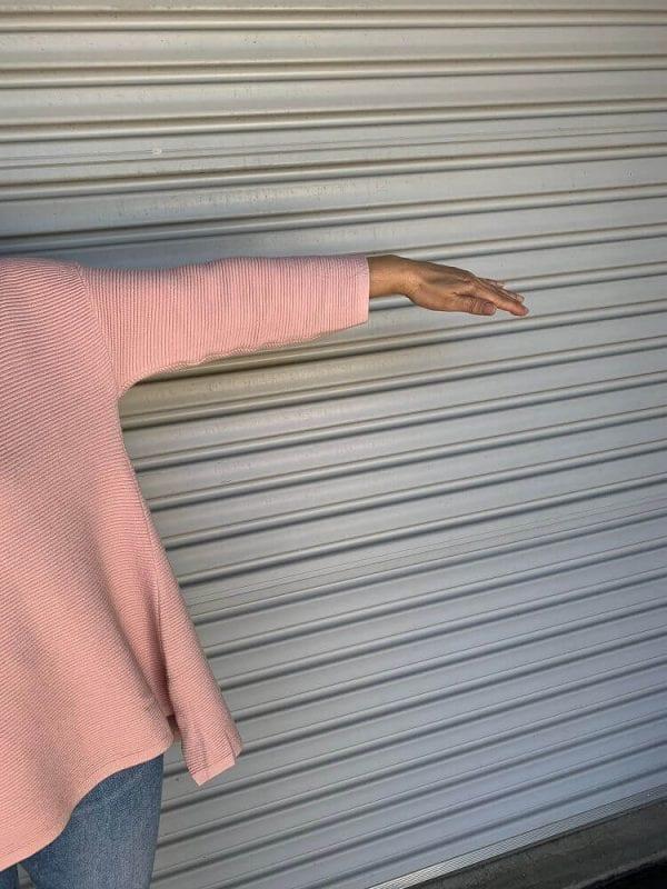 Pink oversized sweater sleeve